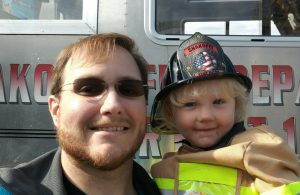 Bradly McGarr with his daughter, Annabelle, at Shakopee Fire Open House